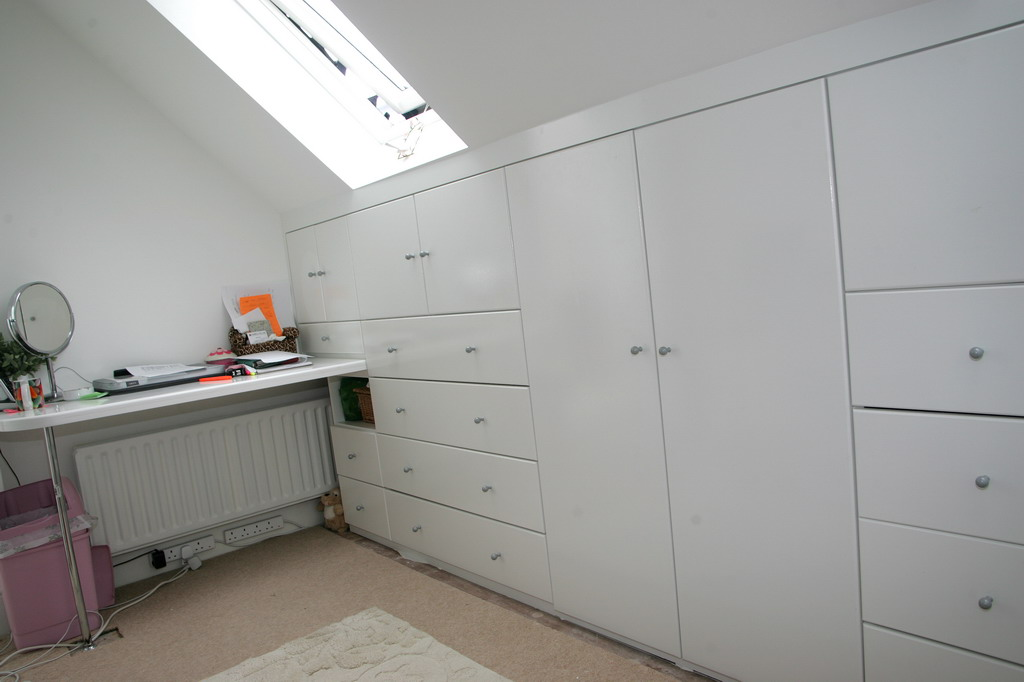 Bedroom wardrobes attic bedroom wardrobes for Loft storage room