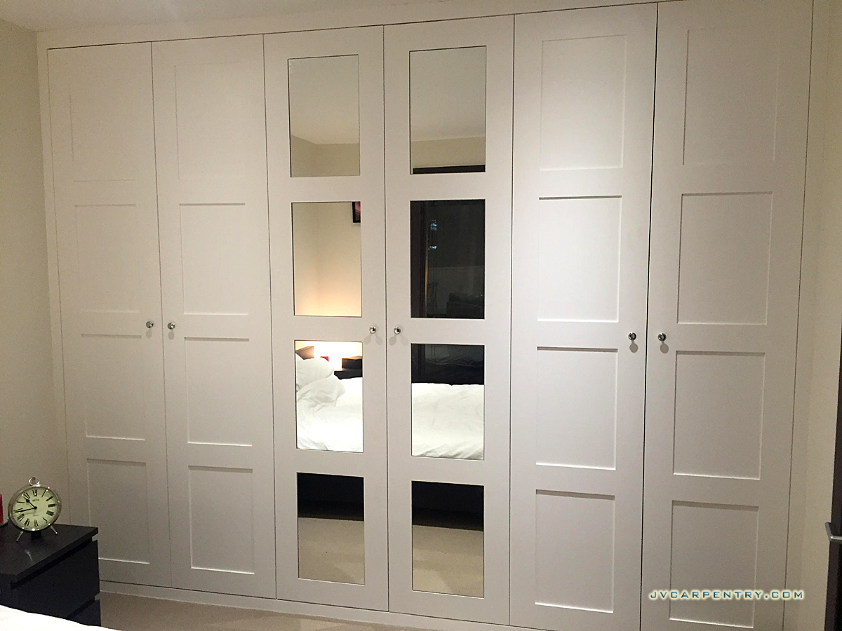 MDF Fitted wardrobe with 4 panneled doors with mirrors
