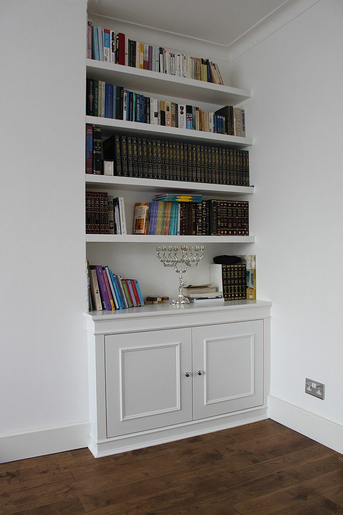 White chunky shelves and alcove cupboard in Hendon