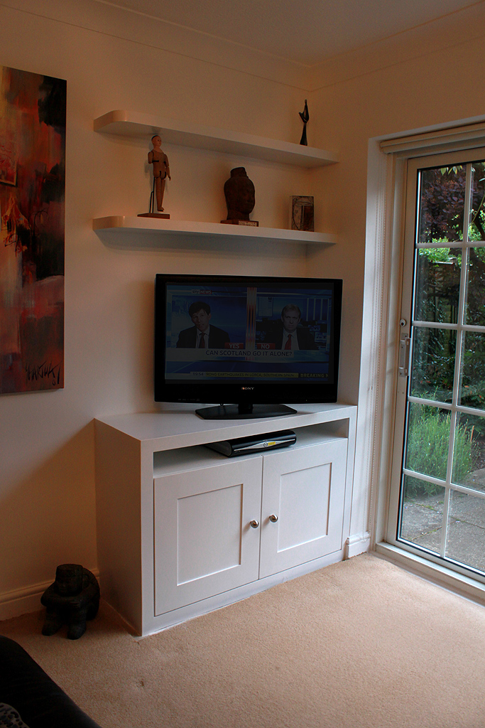 Tv cupboard and curved floating shelves, Harrow
