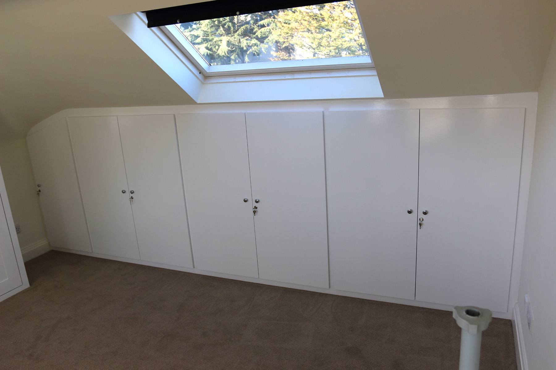Cupboards under the sloping roof