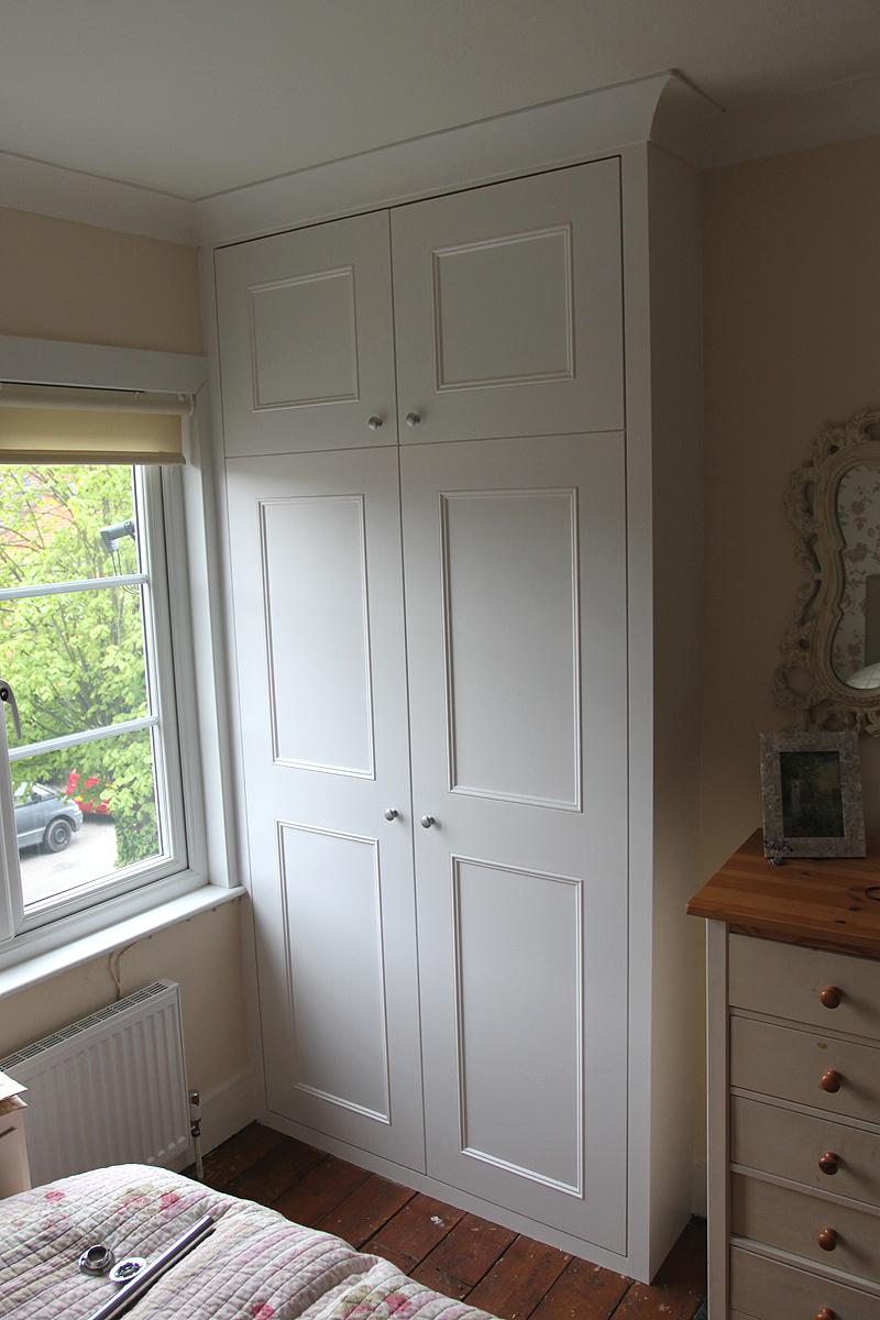 Alcove wardrobe with cornice