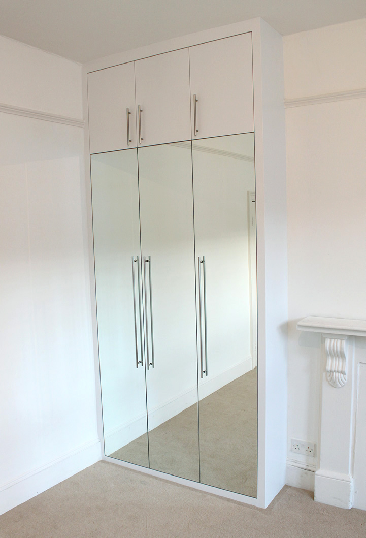Contemporary alcove fitted wardrobe with mirrors on the doors, London, NW6, Kilburn