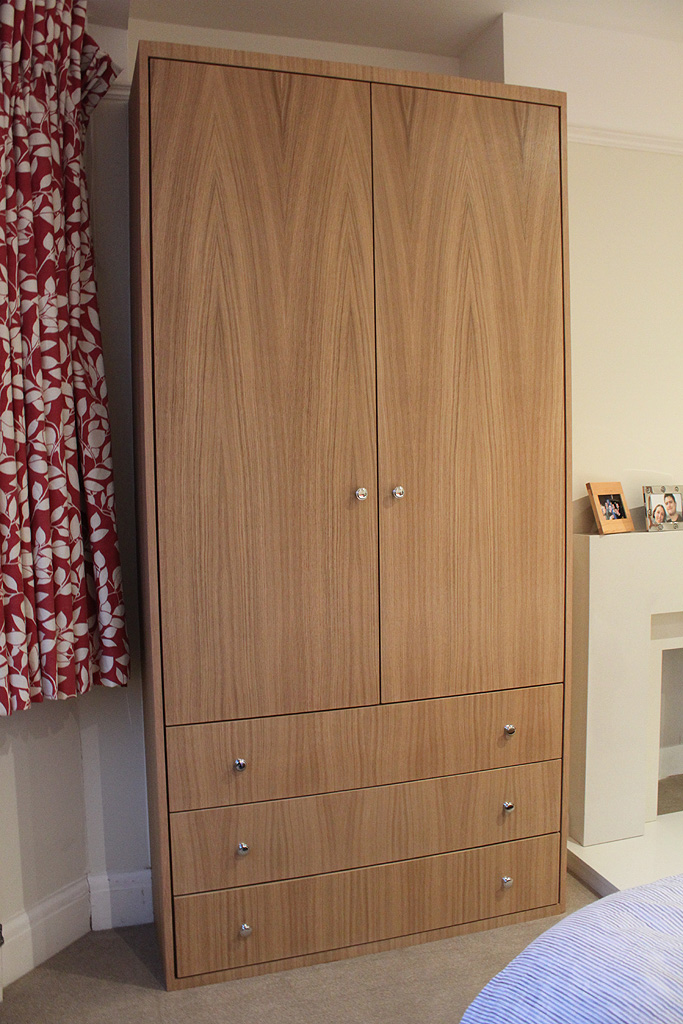 Oak veneer fitted wardrobe with drawers