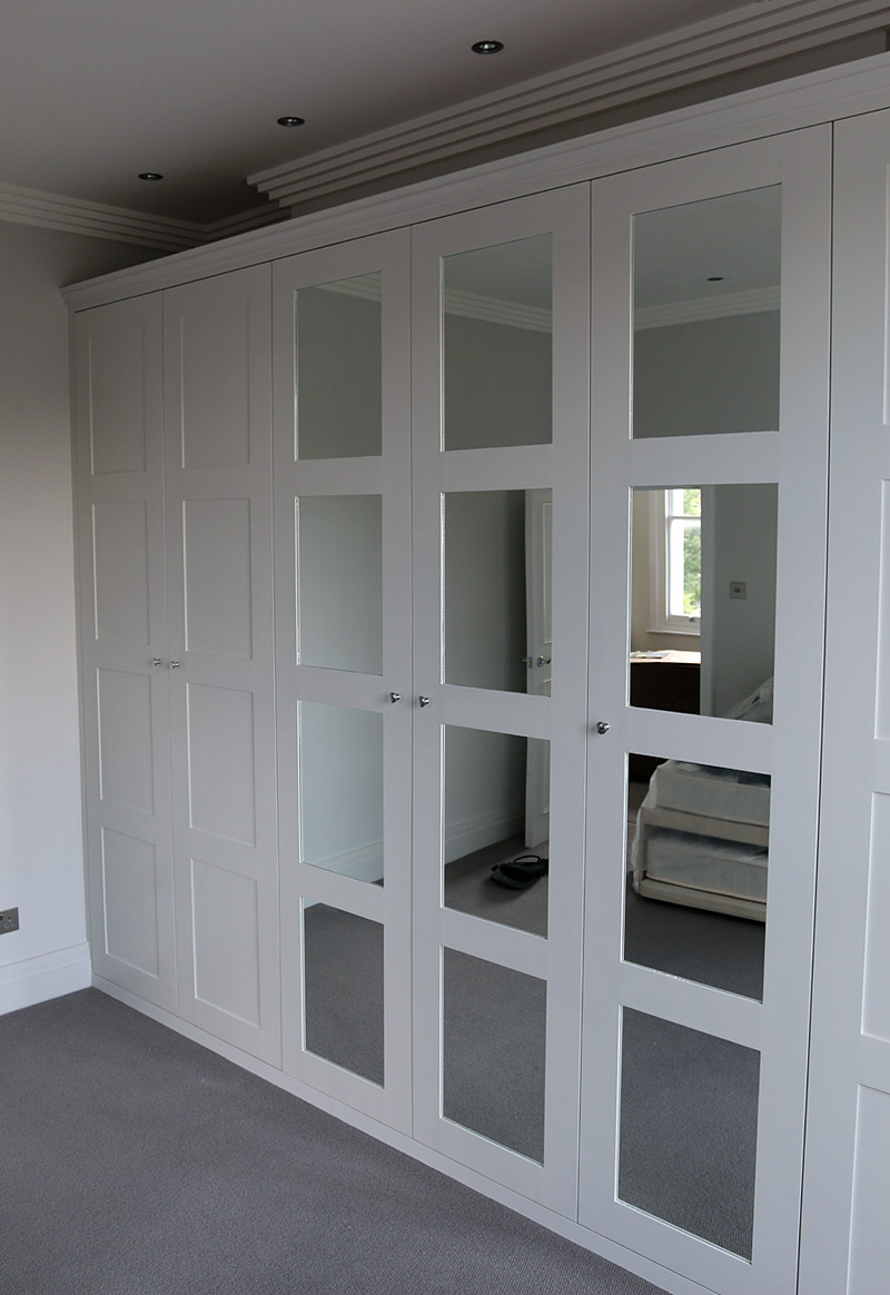 Fitted wardrobe with shaker mirror doors