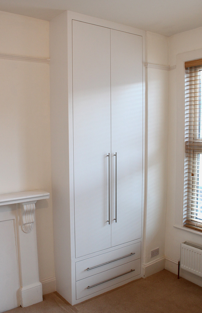 Contemporary, modern fitted alcove wardrobe with drawers. London, NW6, Kilburn