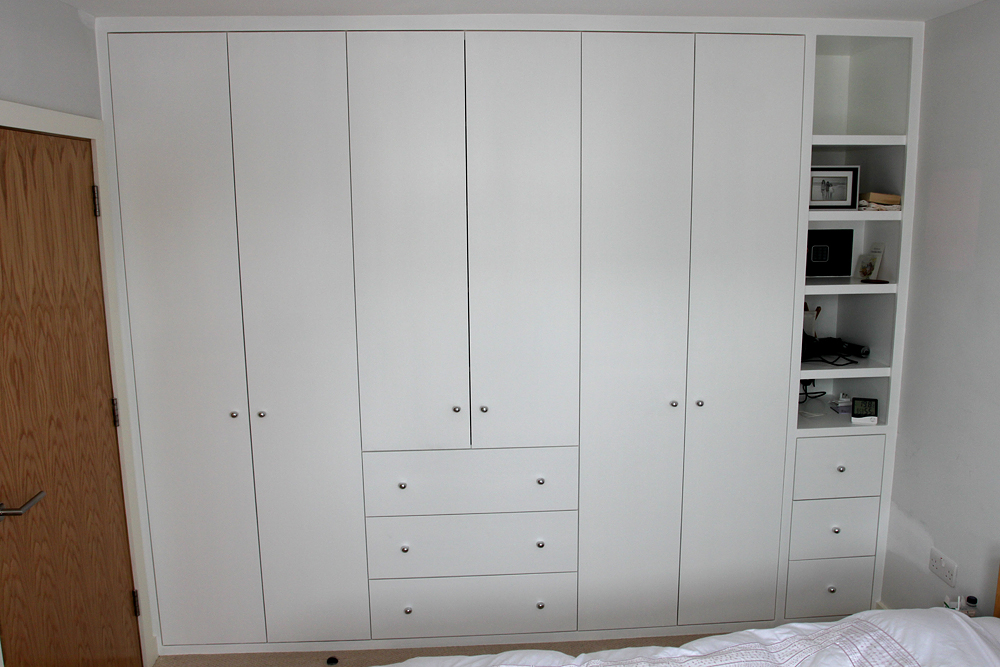 Plain doors wardrobe with drawers and open shelves
