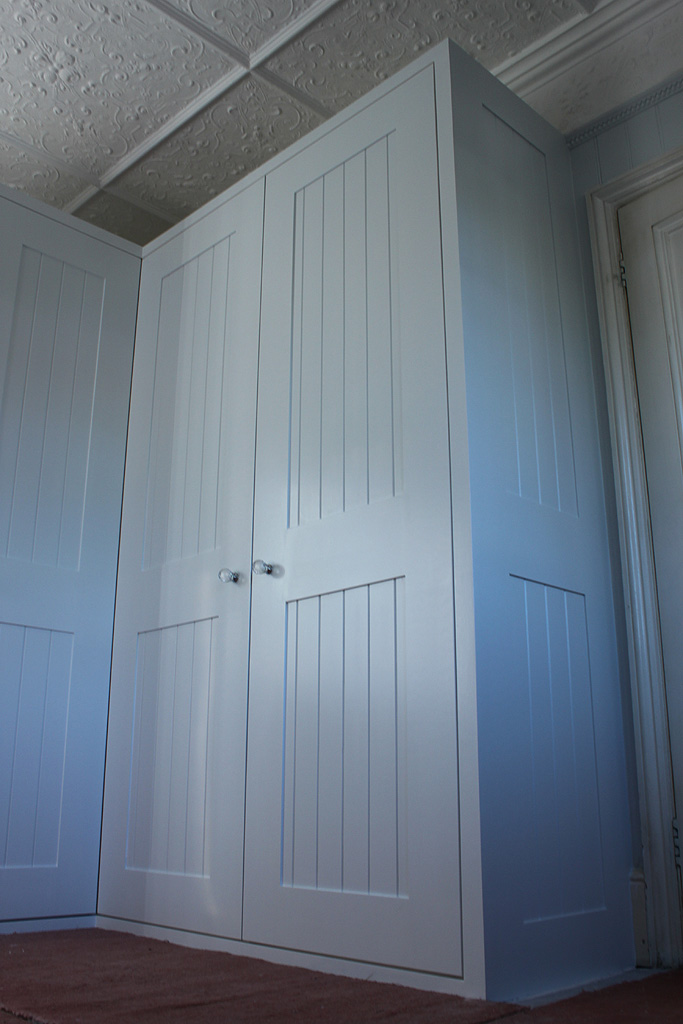 Tongue and groove shaker style fitted wardrobe