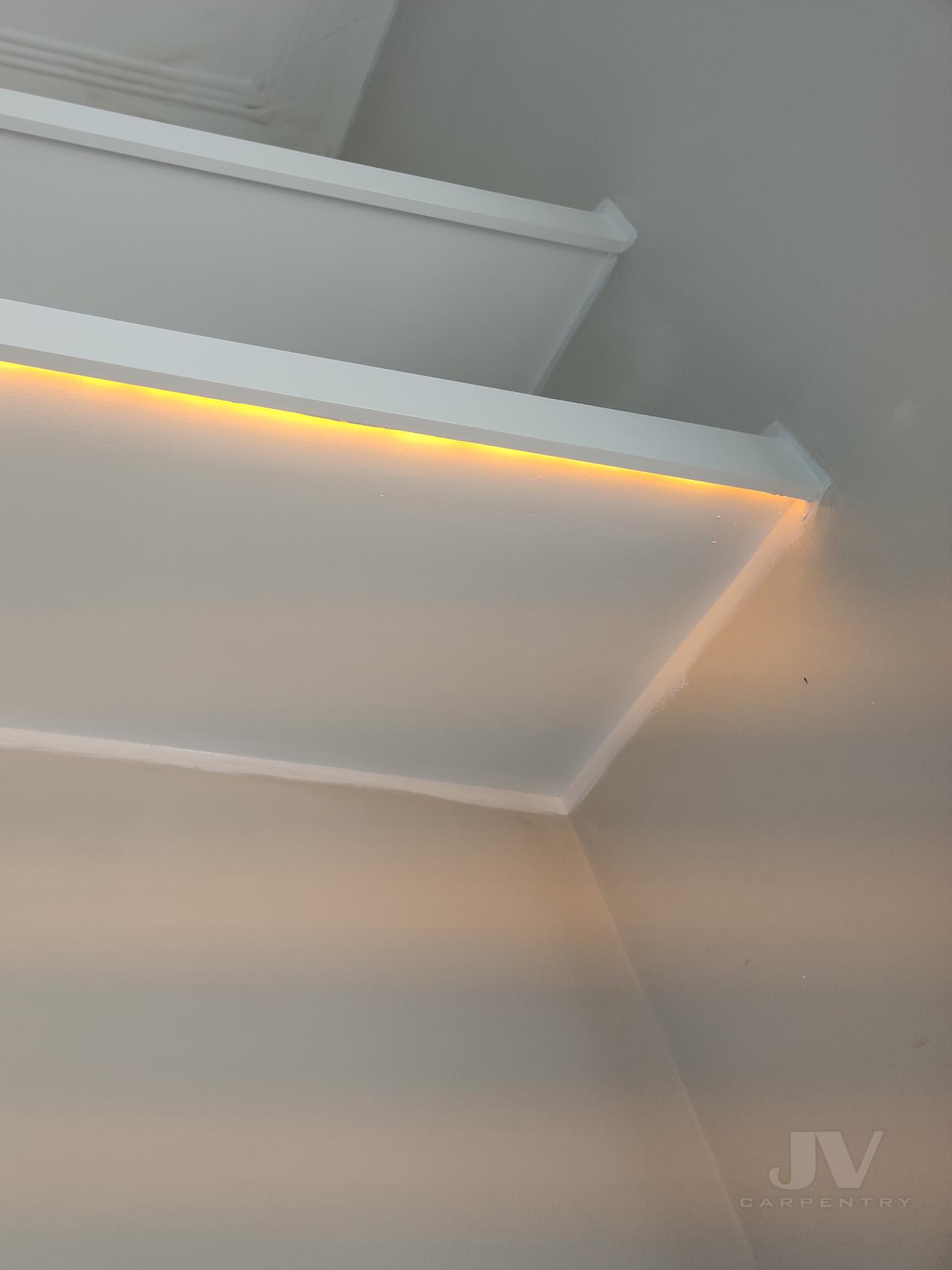 led light underneath floating shelf in alcove