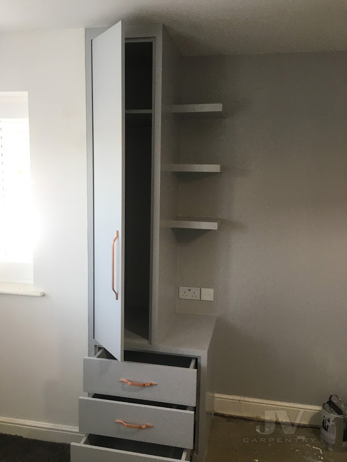 wardrobe with bed side table painting