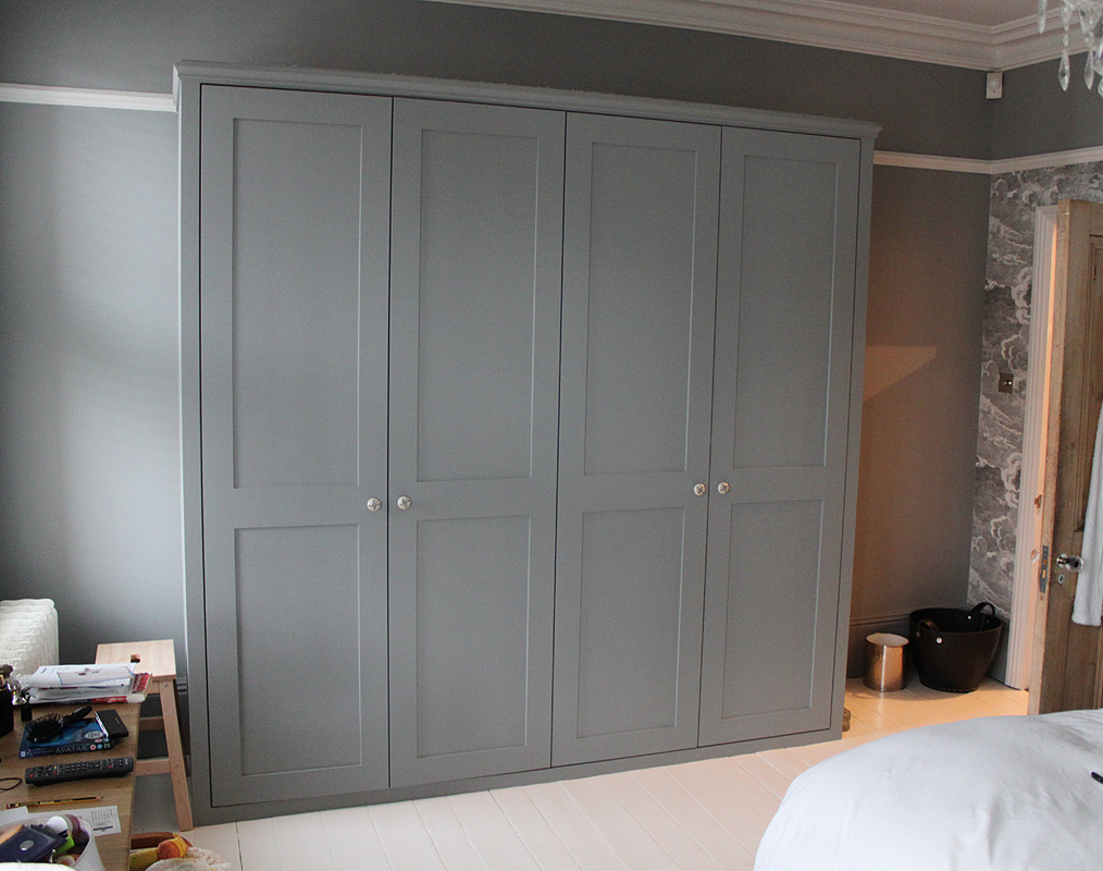 Beautiful grey shaker doors closed on bedroom wardrobe