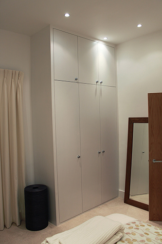 fitted wardrobe with plain doors