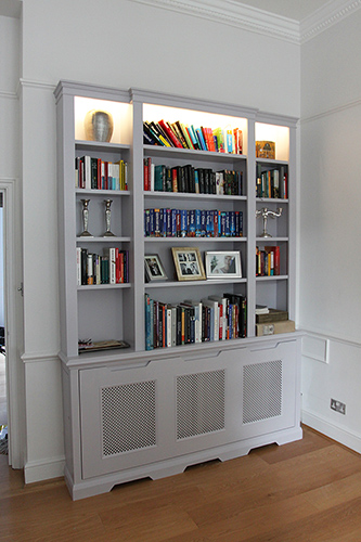 Fitted bookcase and radiator cover