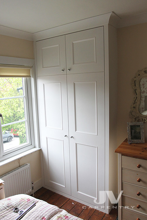 Fitted wardrobe with shaker beaded doors, traditional