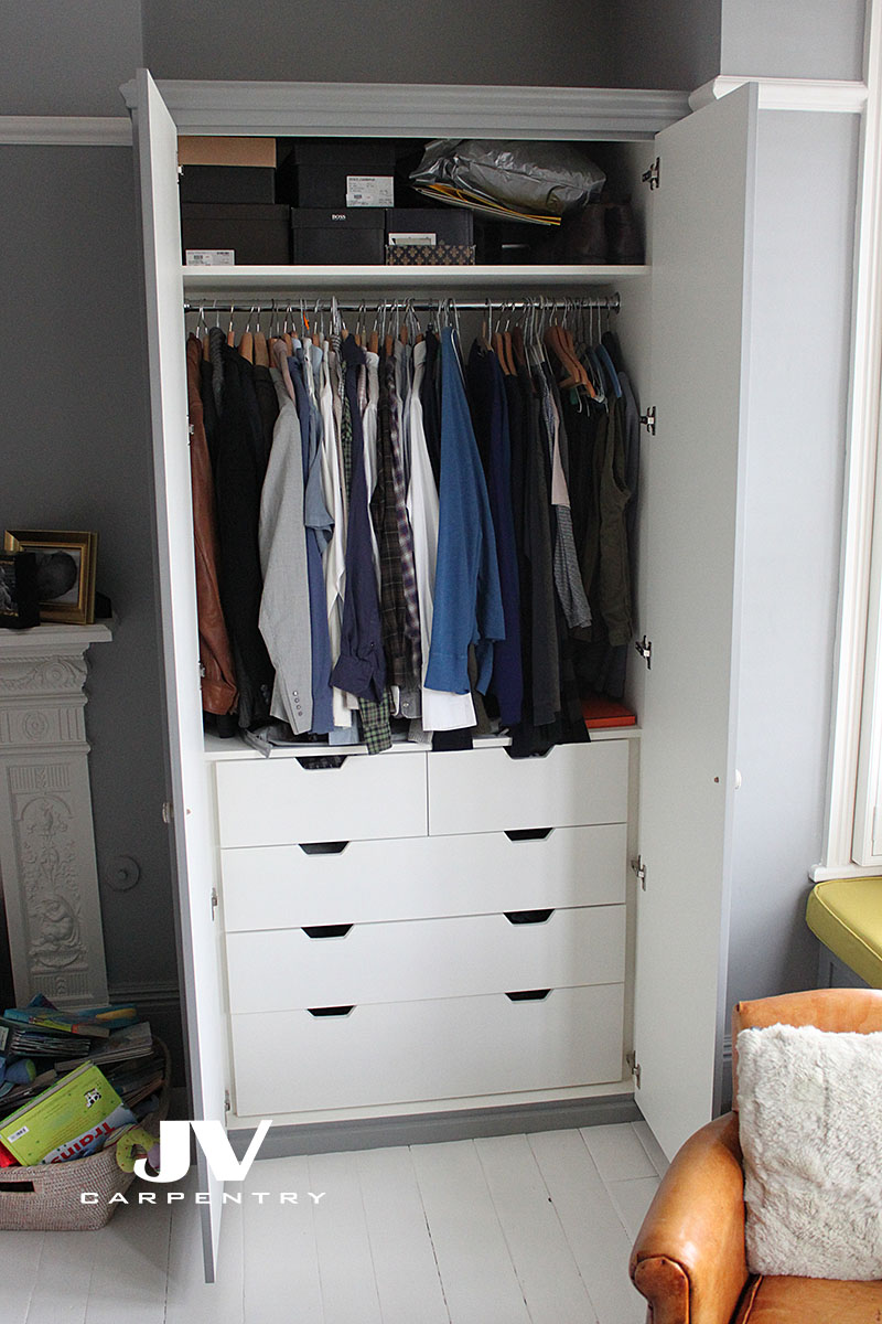 Fitted wardrobe intrior - drawers at the bottom, one splitted drawer at the top. Hanging and shelving space at the top of the wardrobe