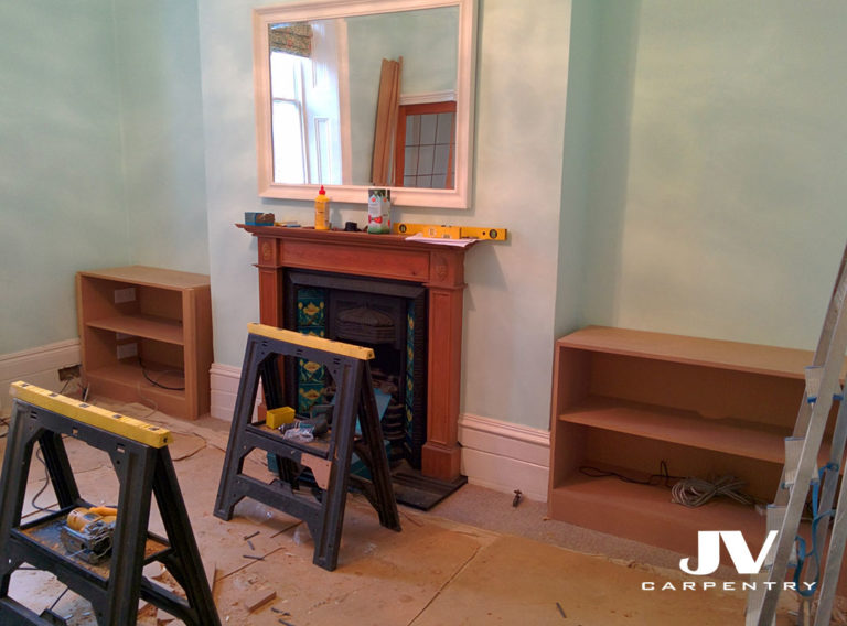 Fitting bottom cupboards into an alcove. Installation process