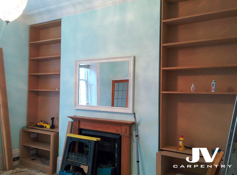 Fitting MDF alcove bookcases above the cupboards.