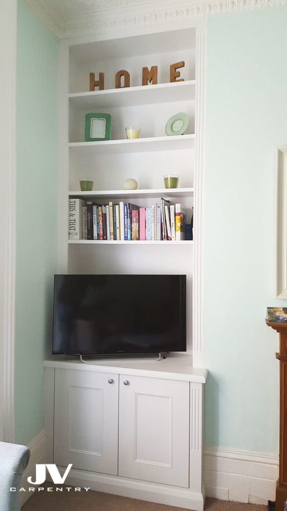 Fitted alcove bookshelves with cabinet at the bottom, victorian style