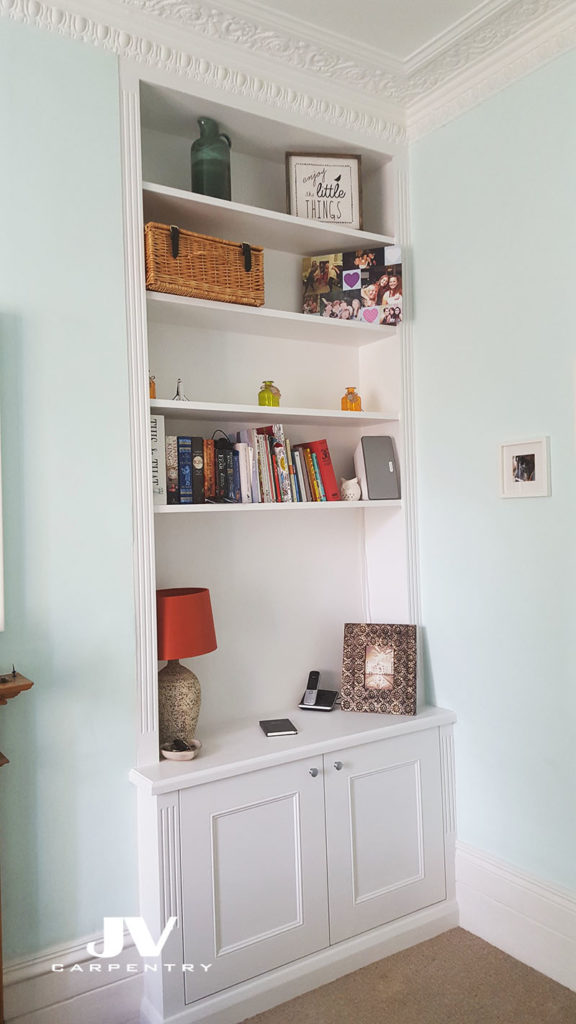 Alcove cupboards with shelves. Alcove bookshelves in livingroom traditional style. Hand painted white eggshell finish