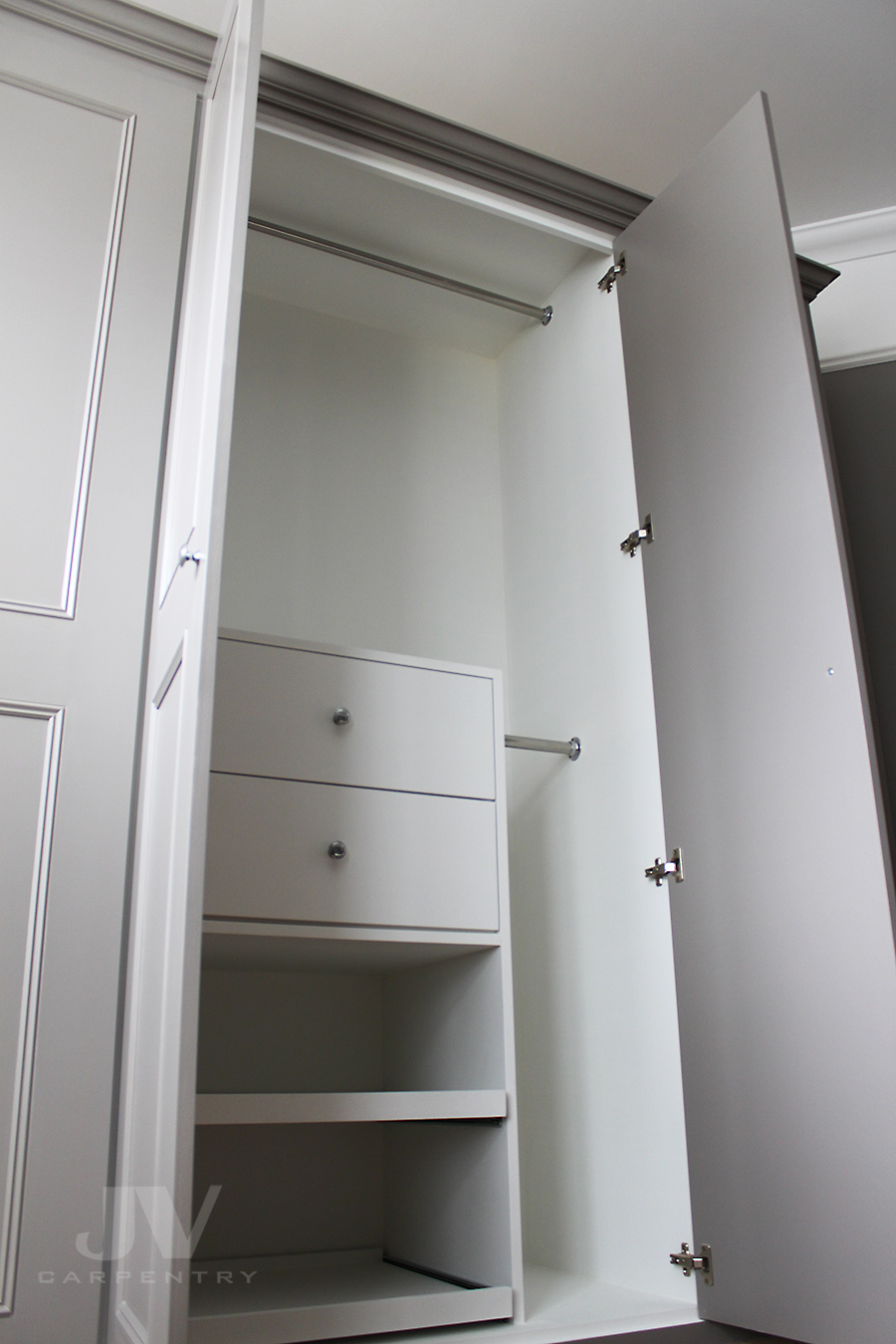 Bedroom wardrobe with drawers and shoe racks inside