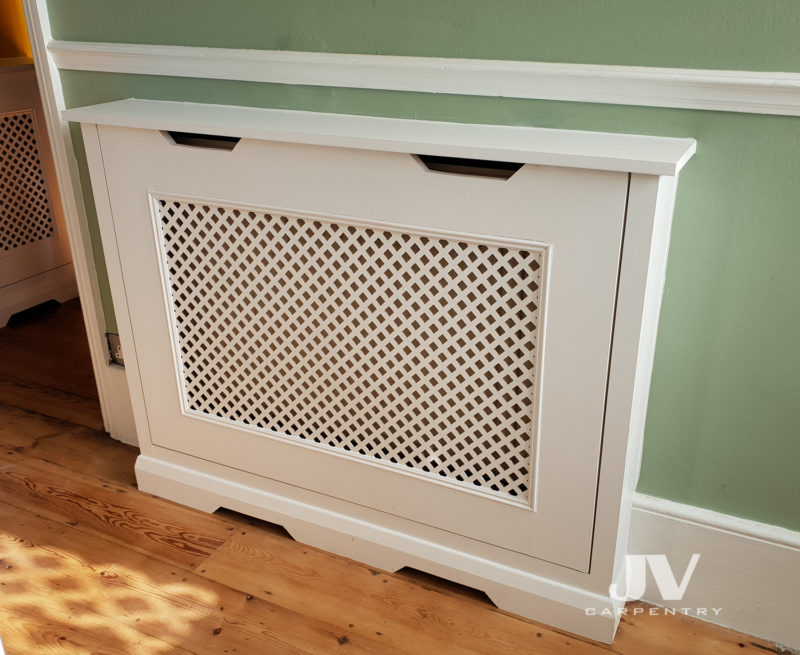 Bespoke radiator cover fitted in the hallway. It's not only hiding the radiator with beautiful piece of fitted furniture, it also give you an extra shelving space and protect your kids for burning their hands