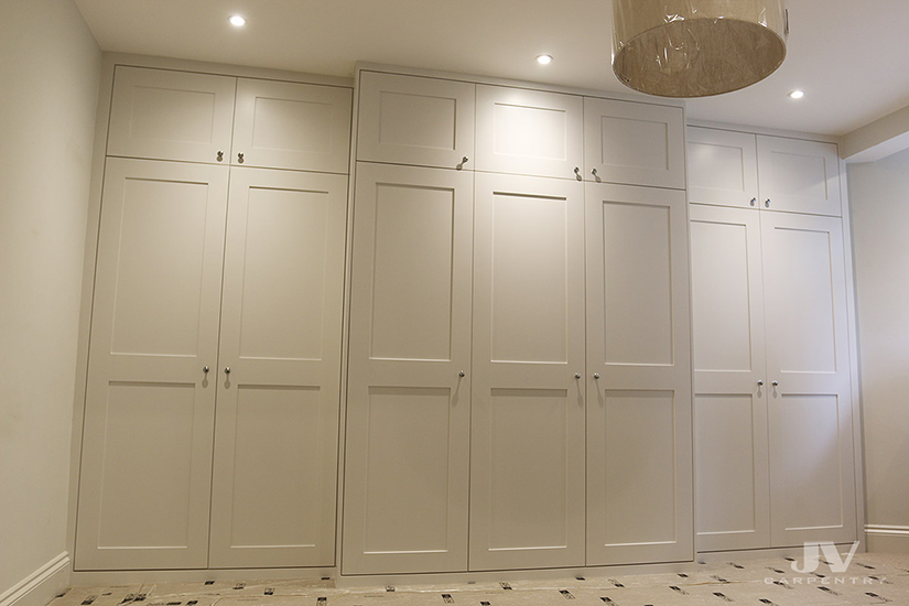 Built-in wardrobe fitted around the chimney breast