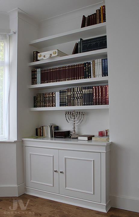 Alcove fitted bookshelves with cabinet at the bottom. Alcove cupboard good ideas
