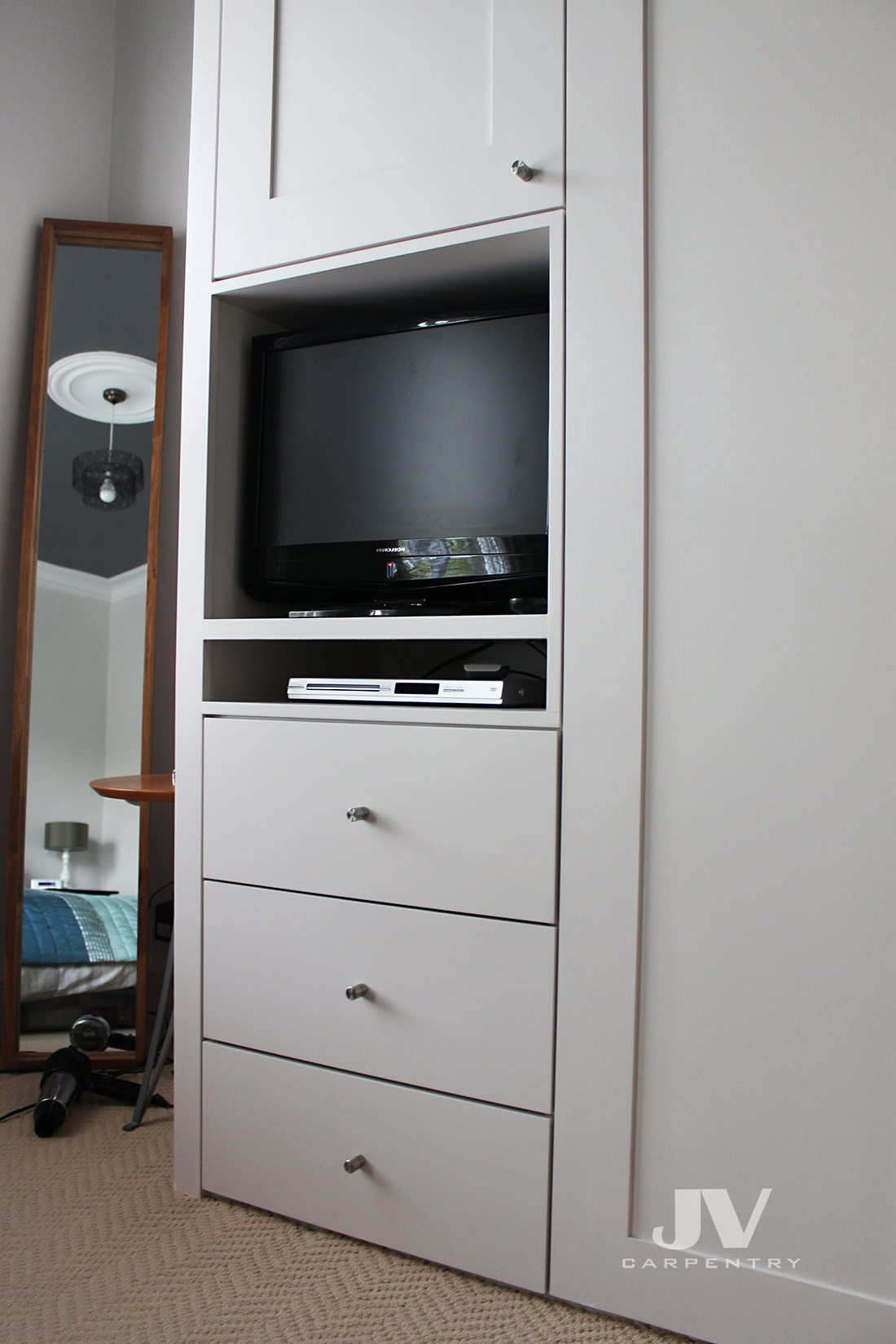 Fitted wardrobe with small TV