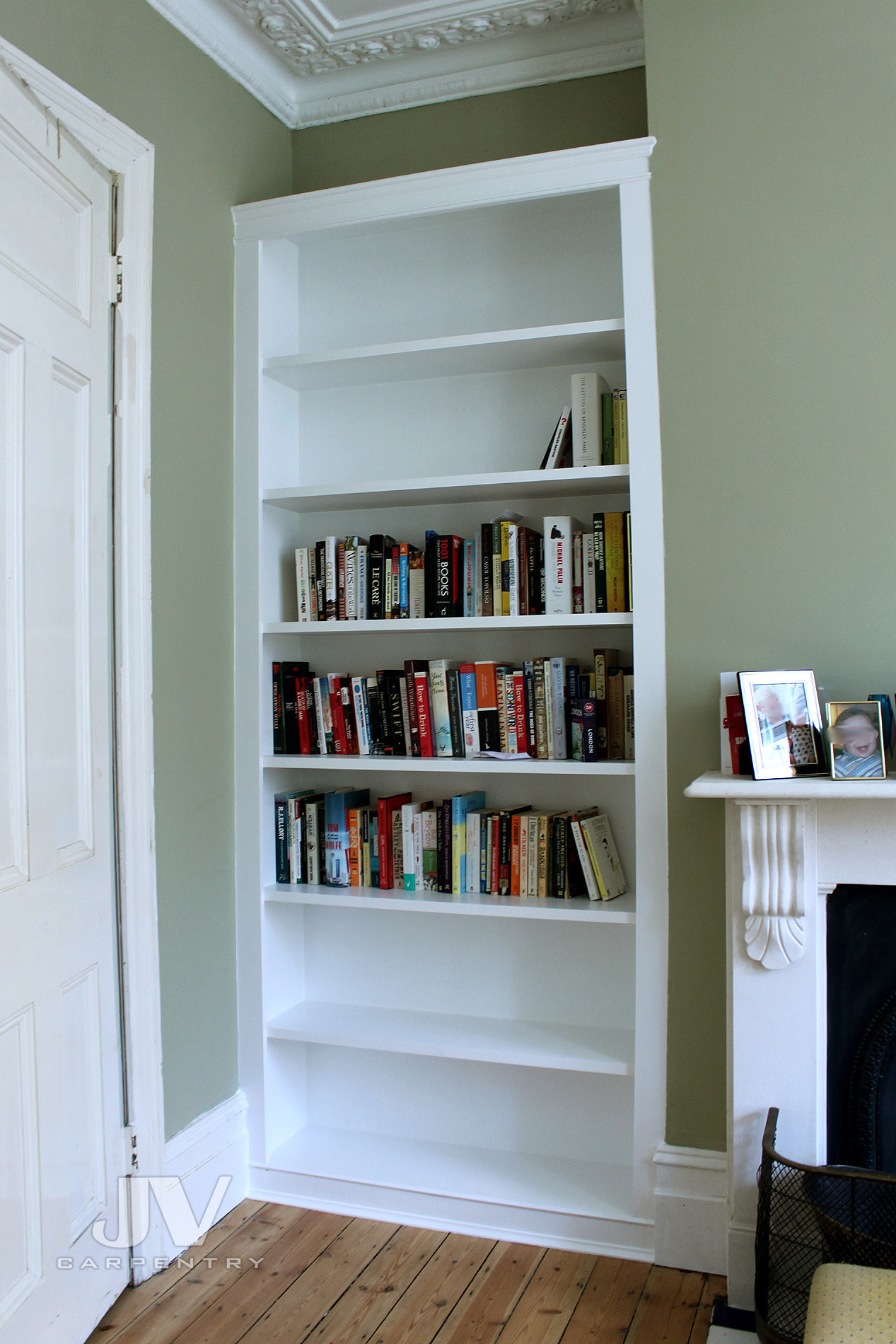 shelving alcove unit with shelves from top to bottom