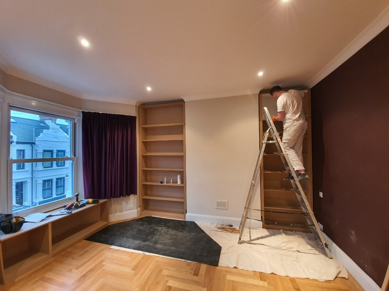 installation and painting of the fitted wardrobes