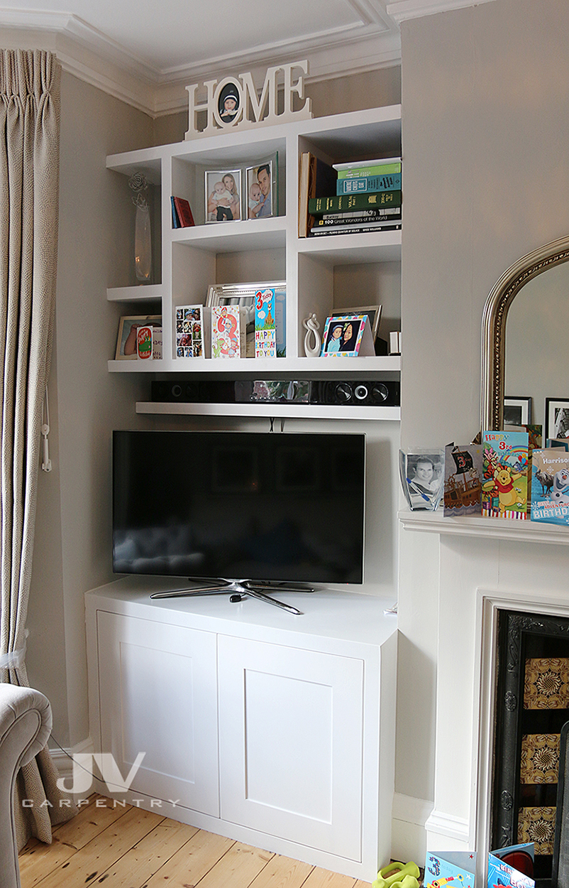 Alcove tv cabinet with floating shelves above