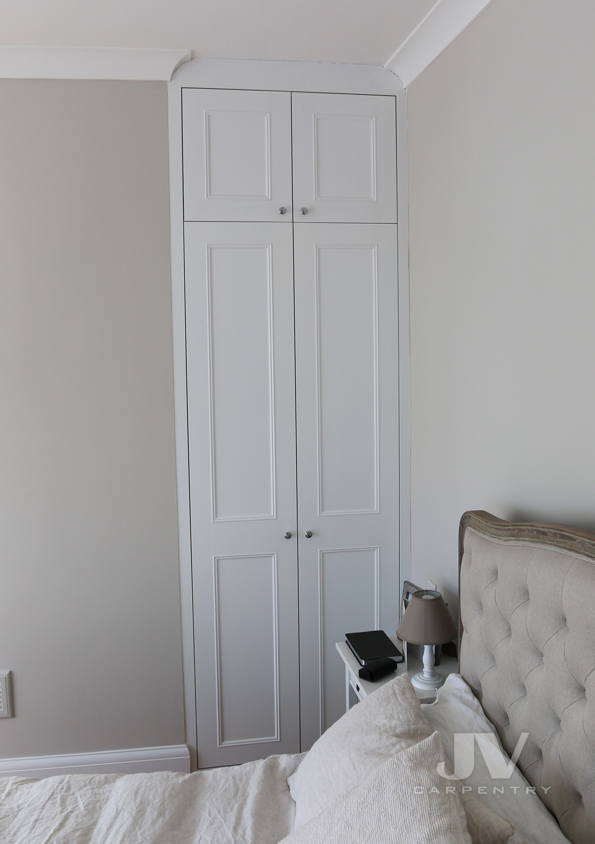 bespoke wardrobe fitted in the bedroom alcove