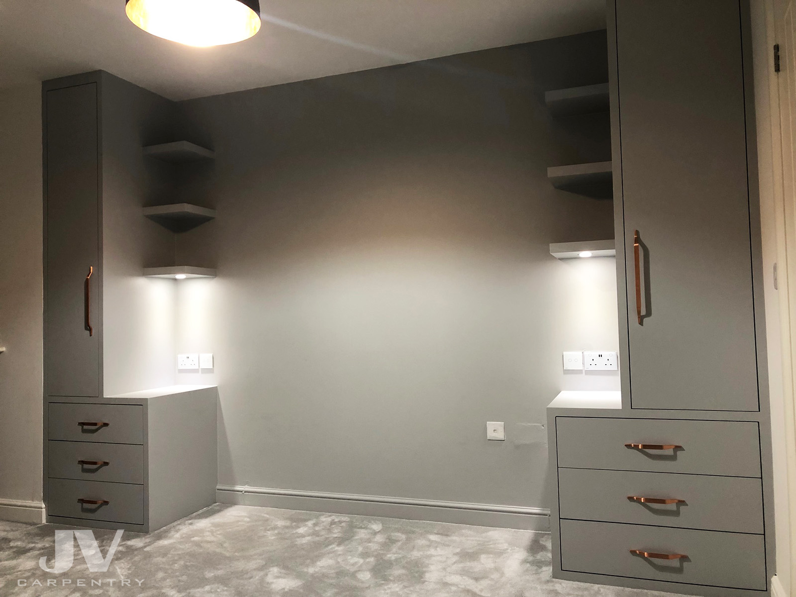 Small fitted wardrobes either side of the bed