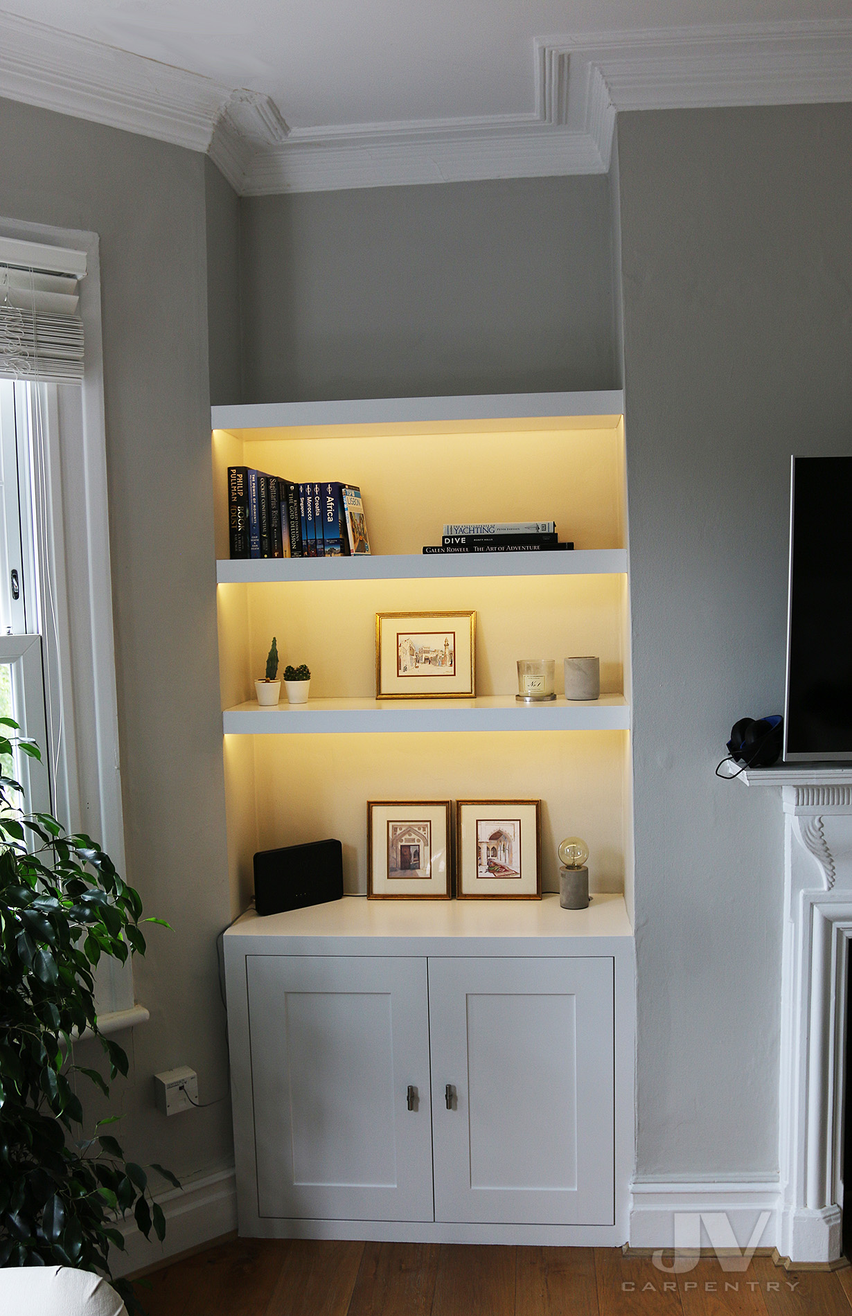 alcove shelving with lights and cabinet at the bottom LHS