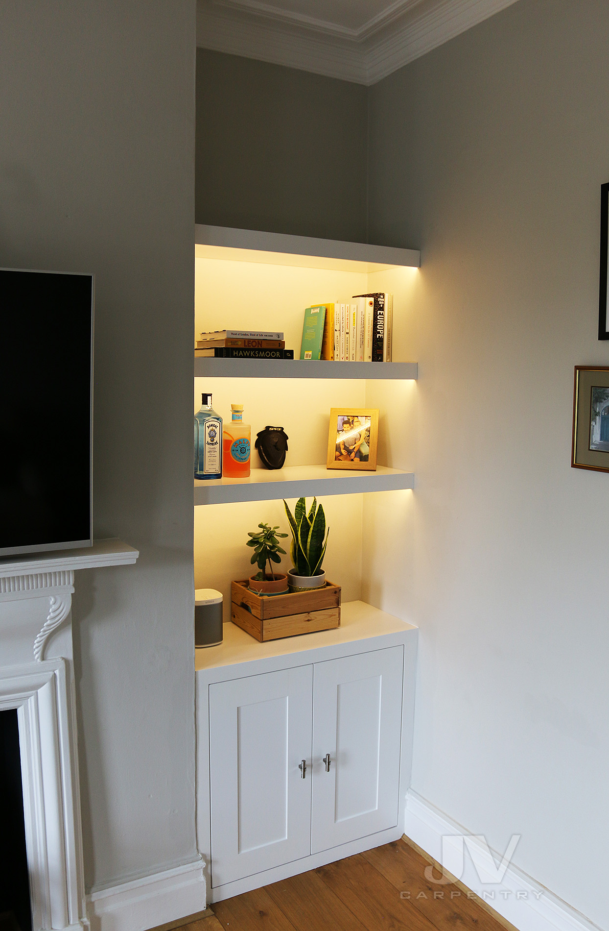alcove floating shelving with lights and cabinet at the bottom RHS