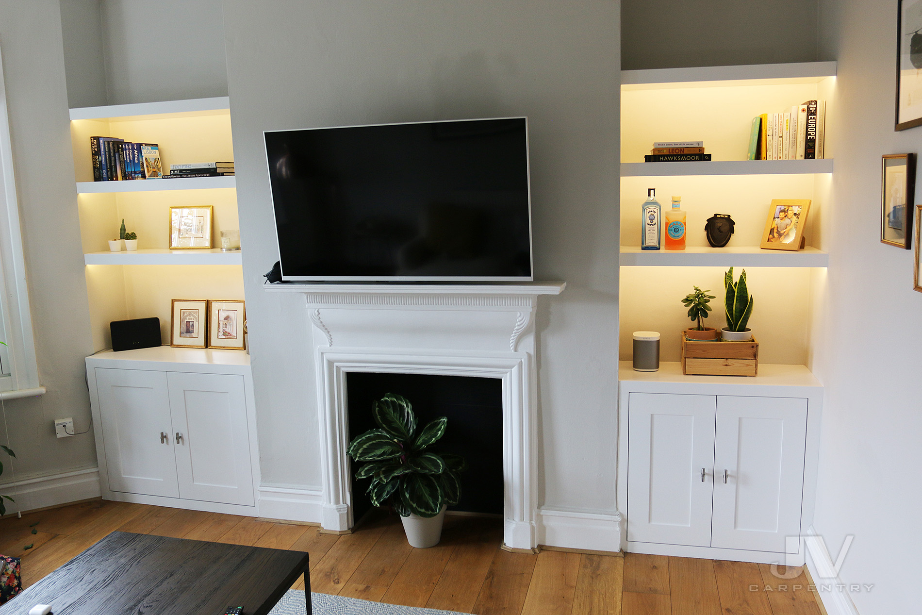 Alcove bookshelves with lights