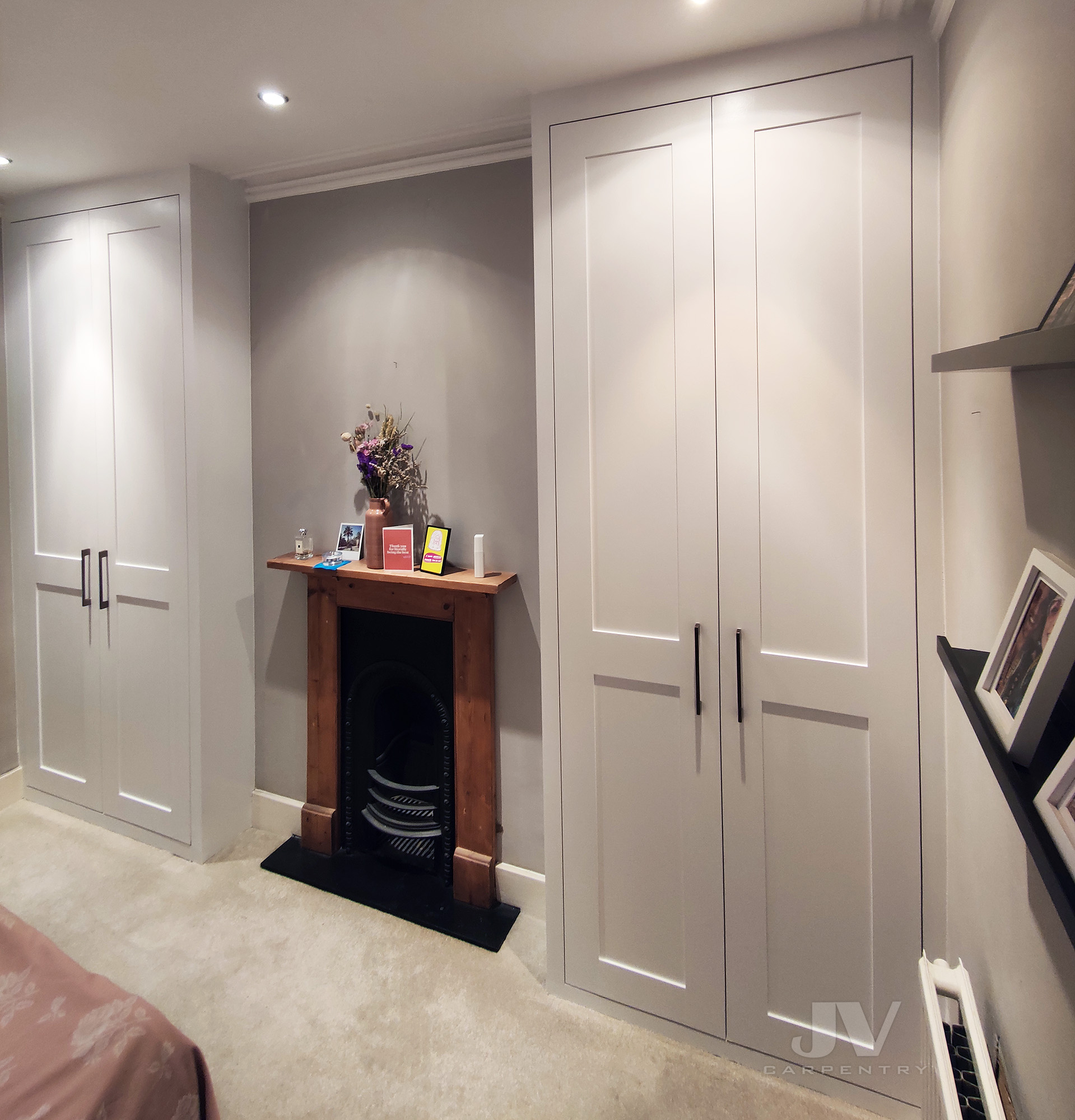 two alcove wardrobes with shaker doors