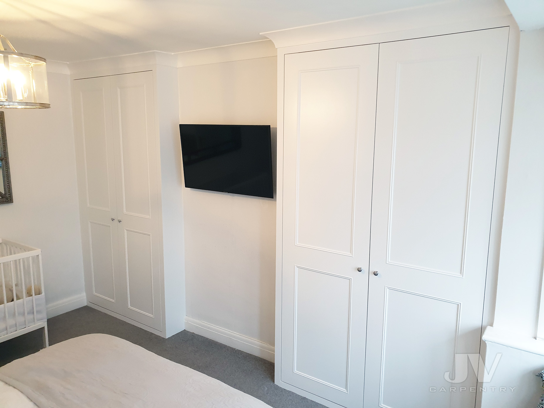 two white alcove wardrobes