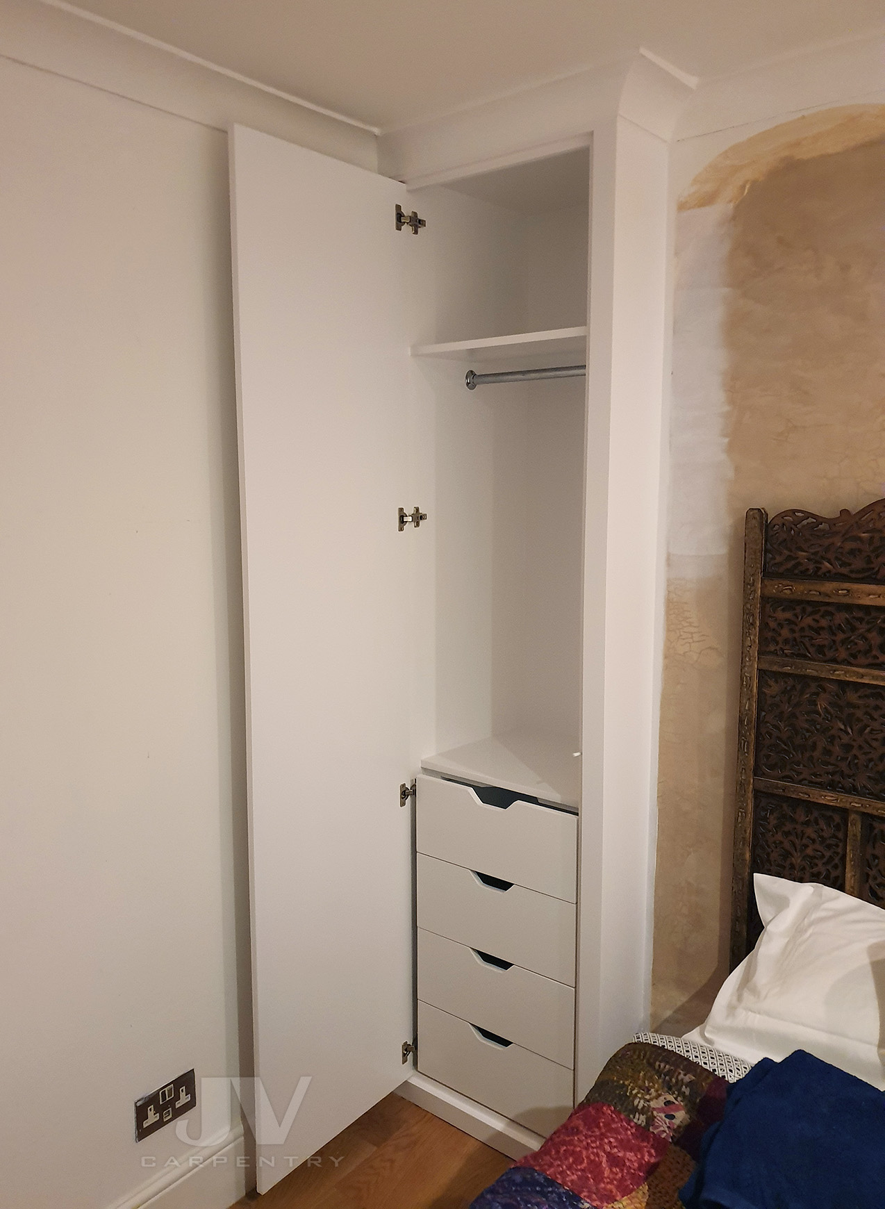 small alcove wardrobe with open doors