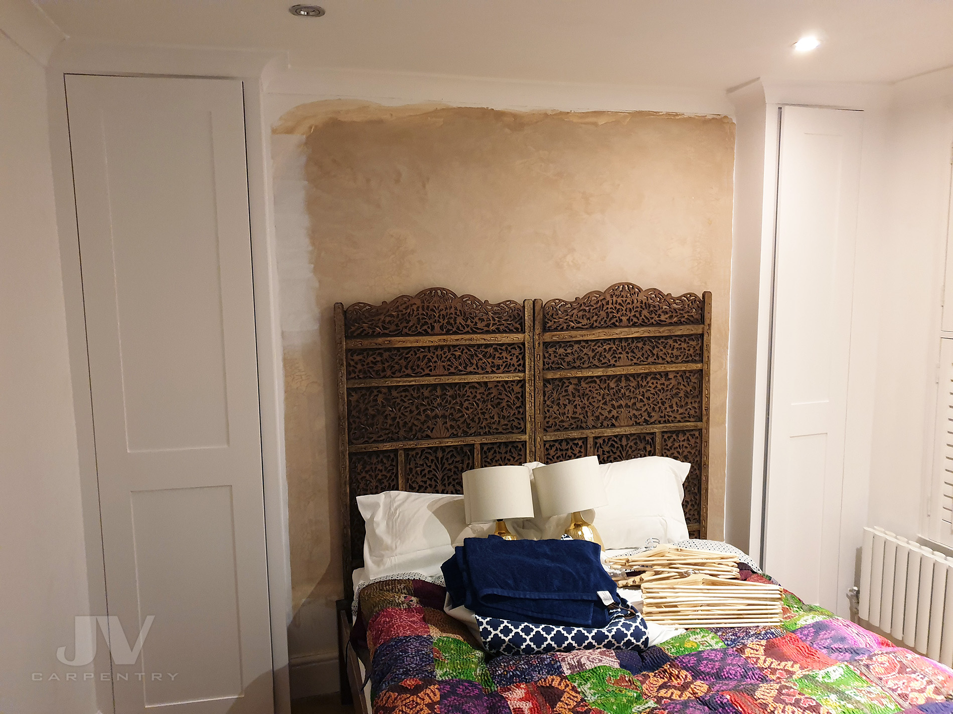 Small alcove wardrobes in bedroom