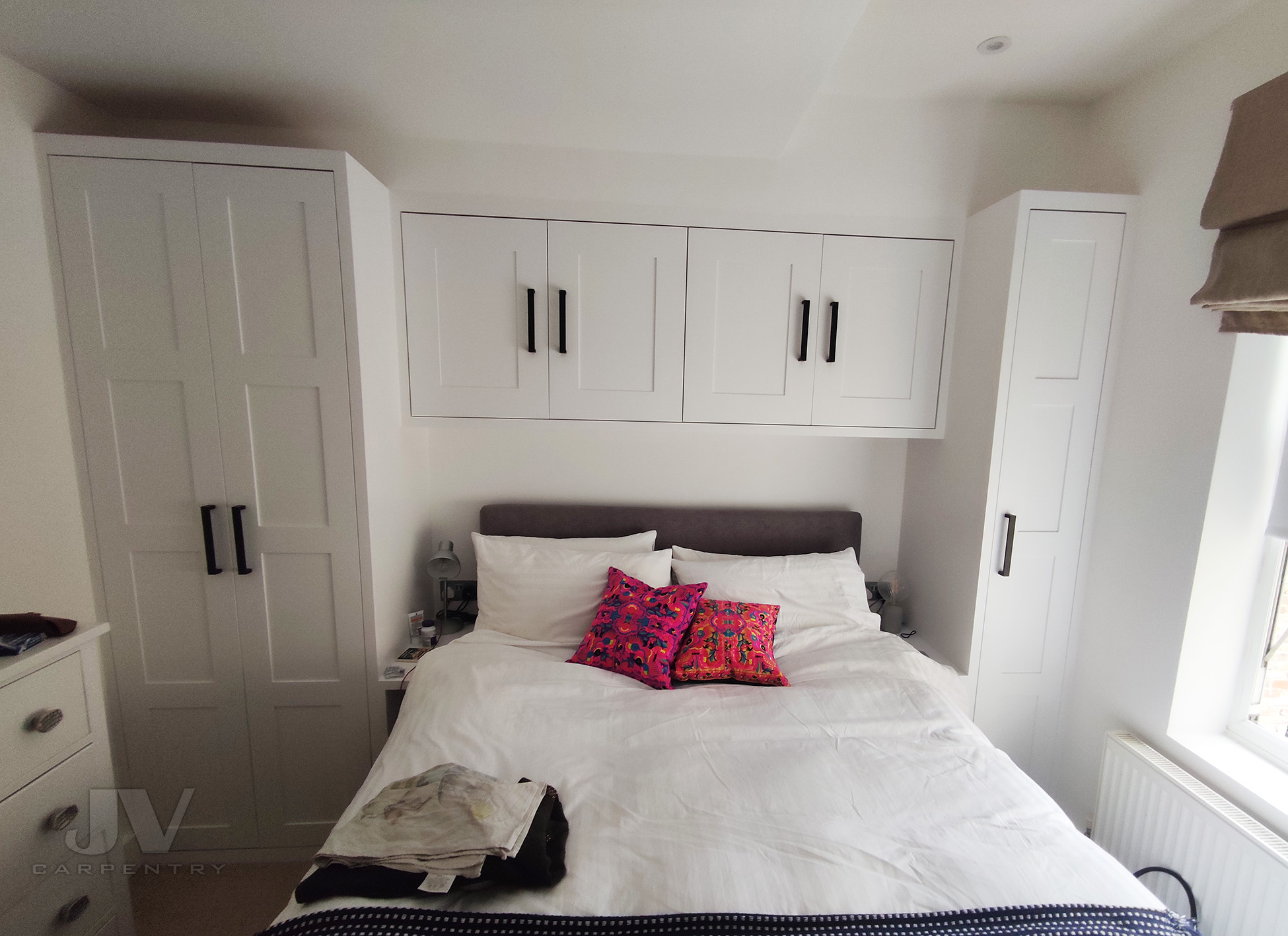 small bedroom wardrobe with over bed storage