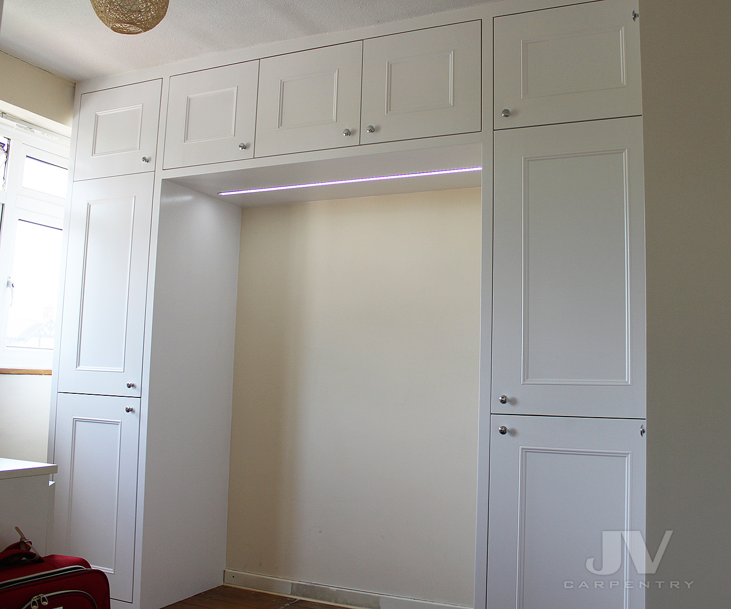 overbed fitted wardrobe
