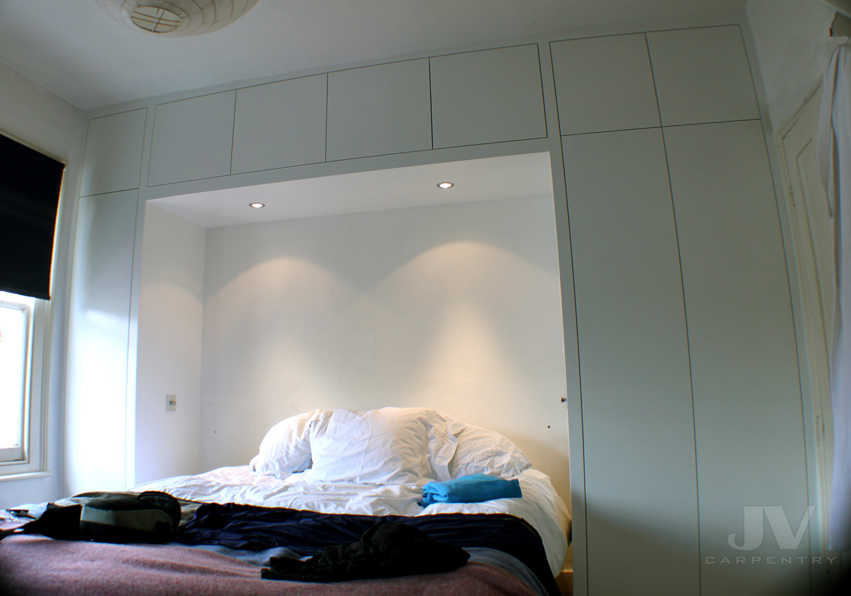 fitted wardrobe over the bed