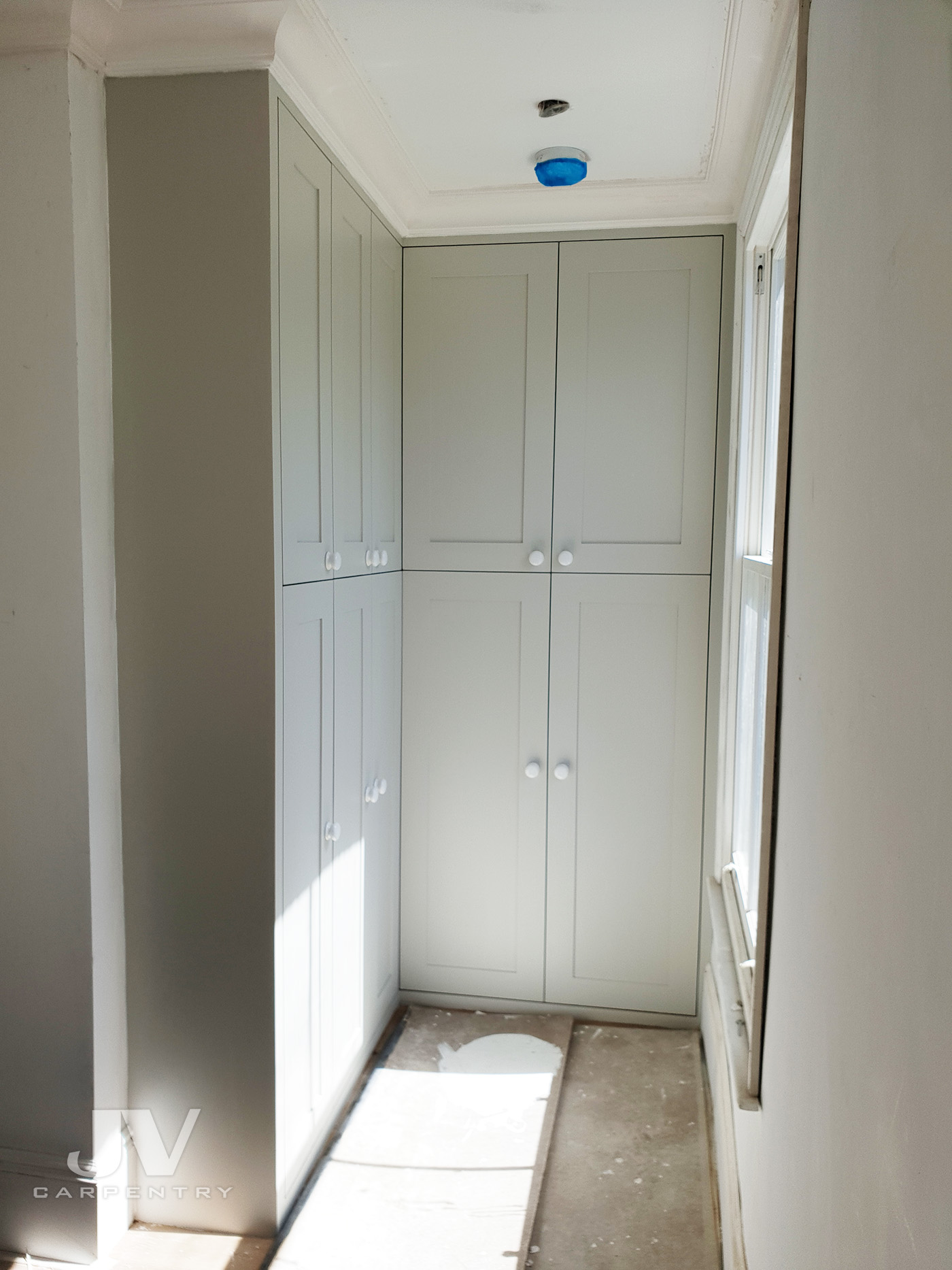 fitted wardrobe opposite the window