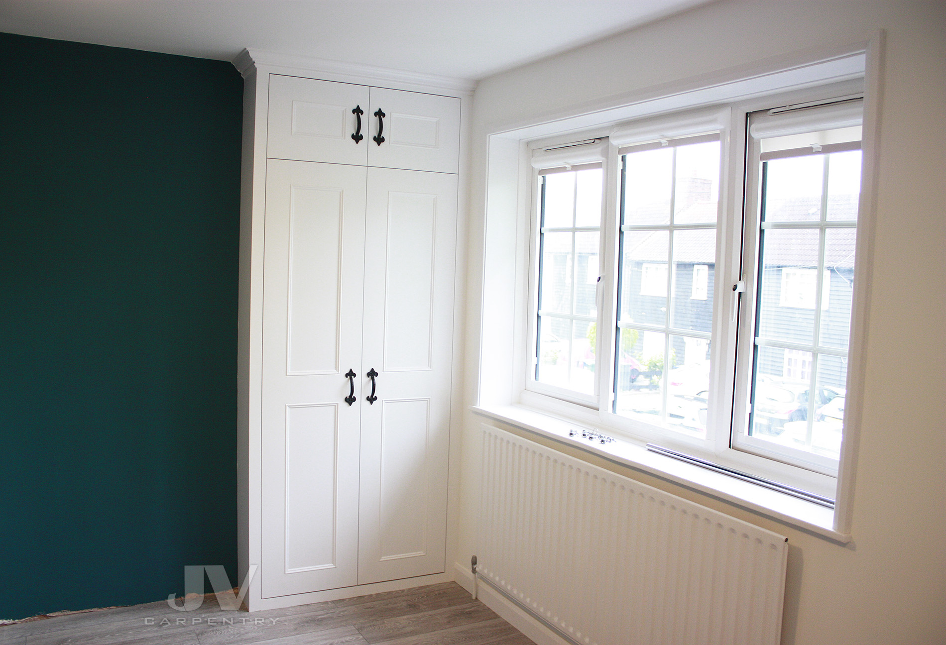 fitted wardrobe close to the window