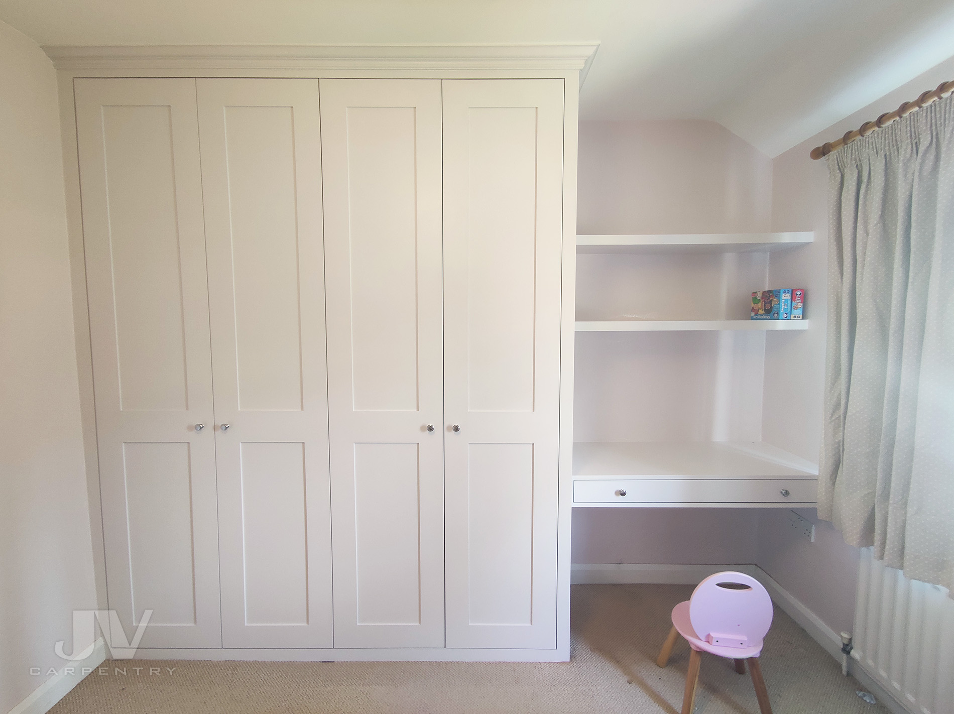 Built-in wardrobe with dressing table and shelves in Camden town