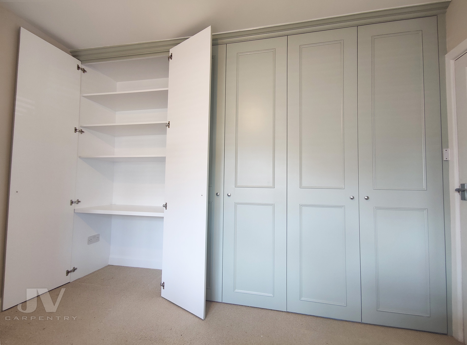 fitted wardrobe with dressing table inside