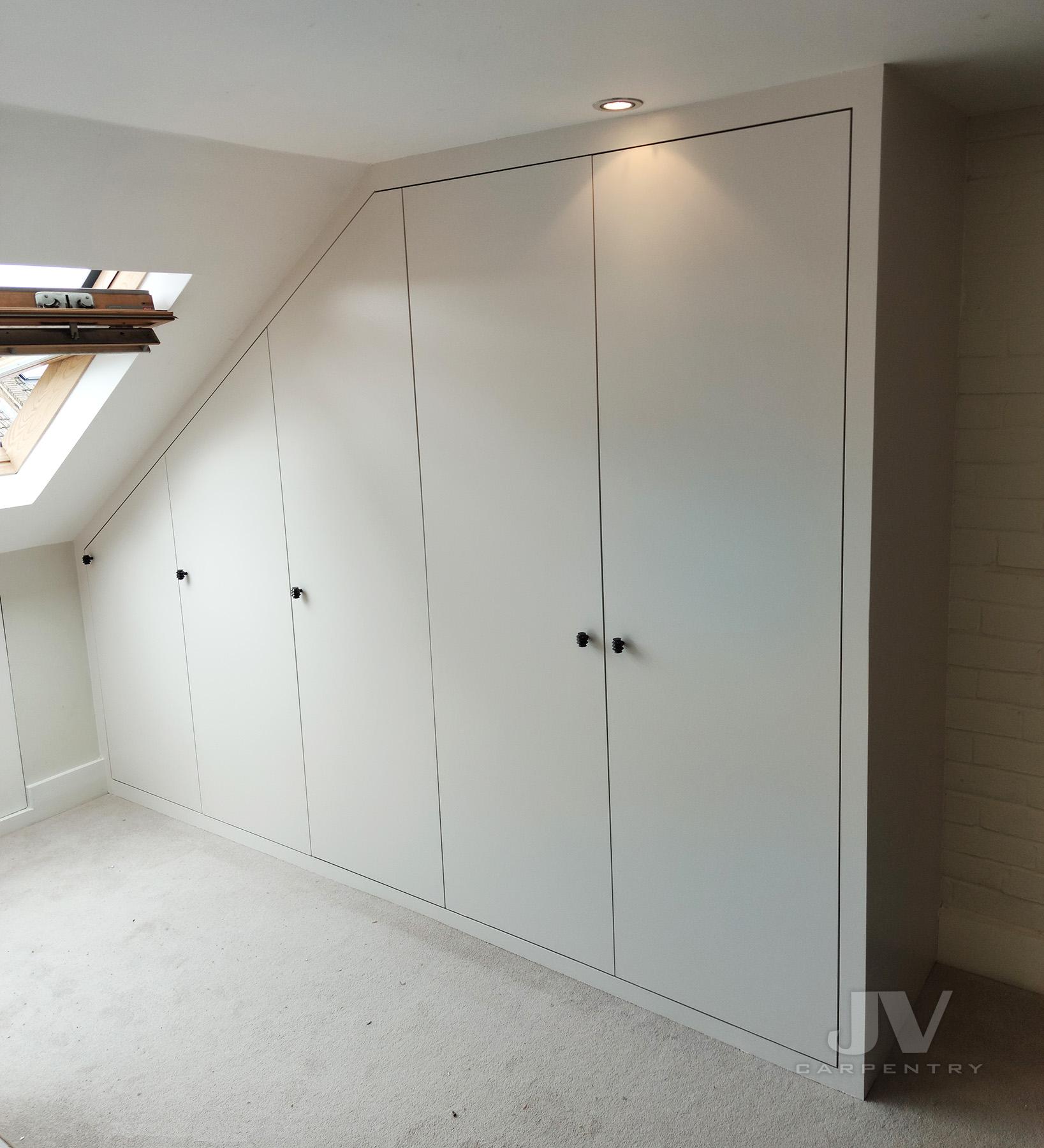 Attic wardrobe under sloping ceiling