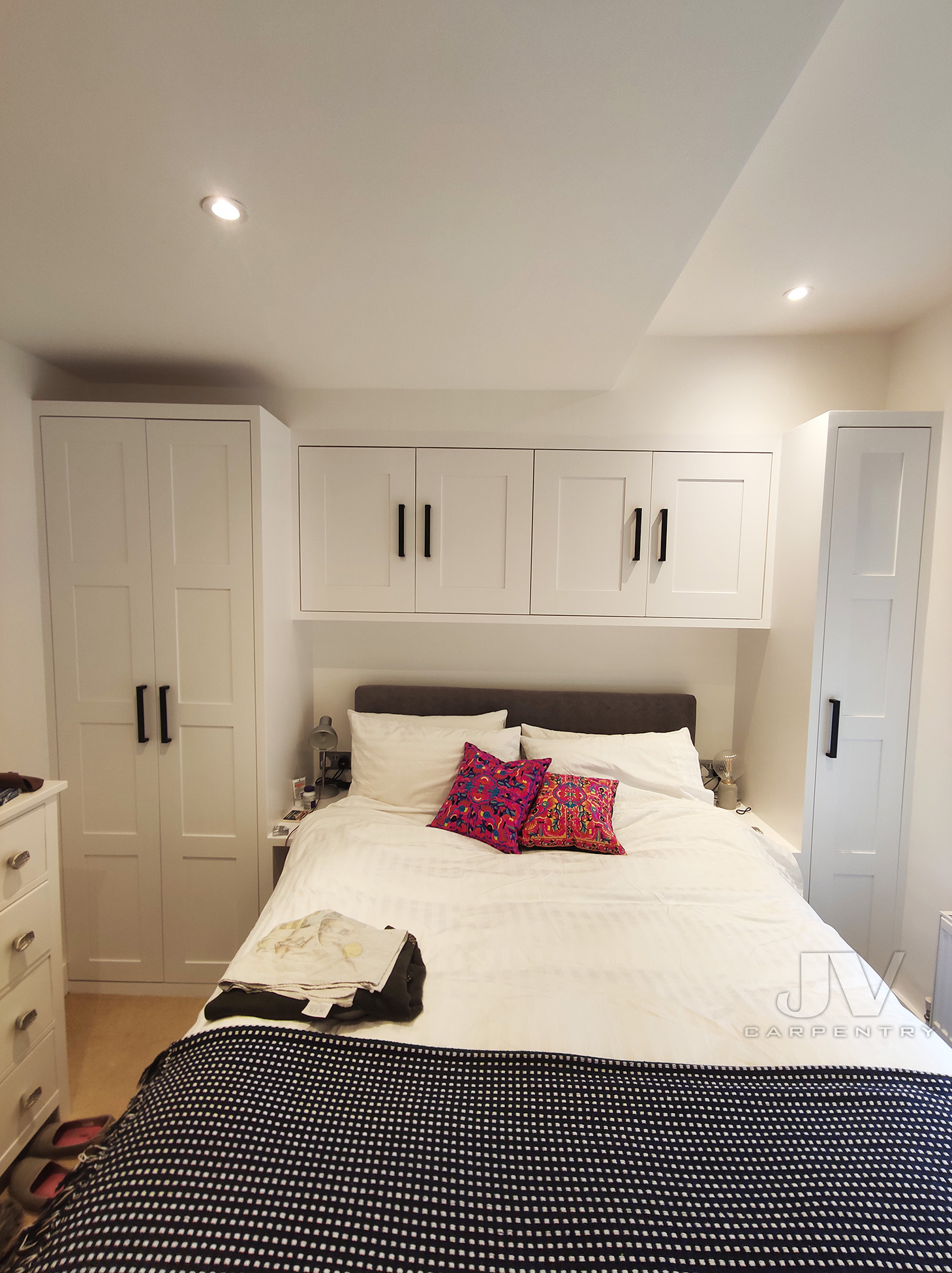 wardrobe with over the bed cupboards