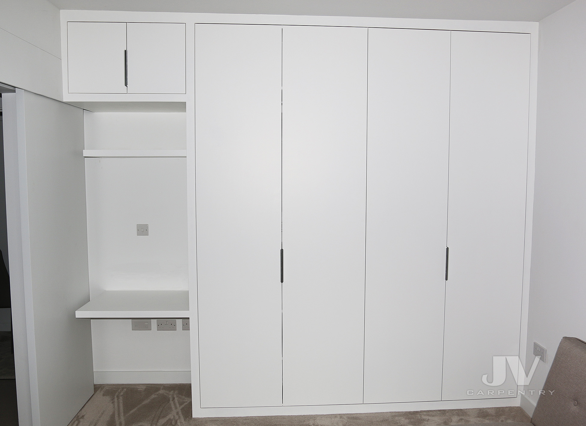 white fitted wardrobe with dressing table